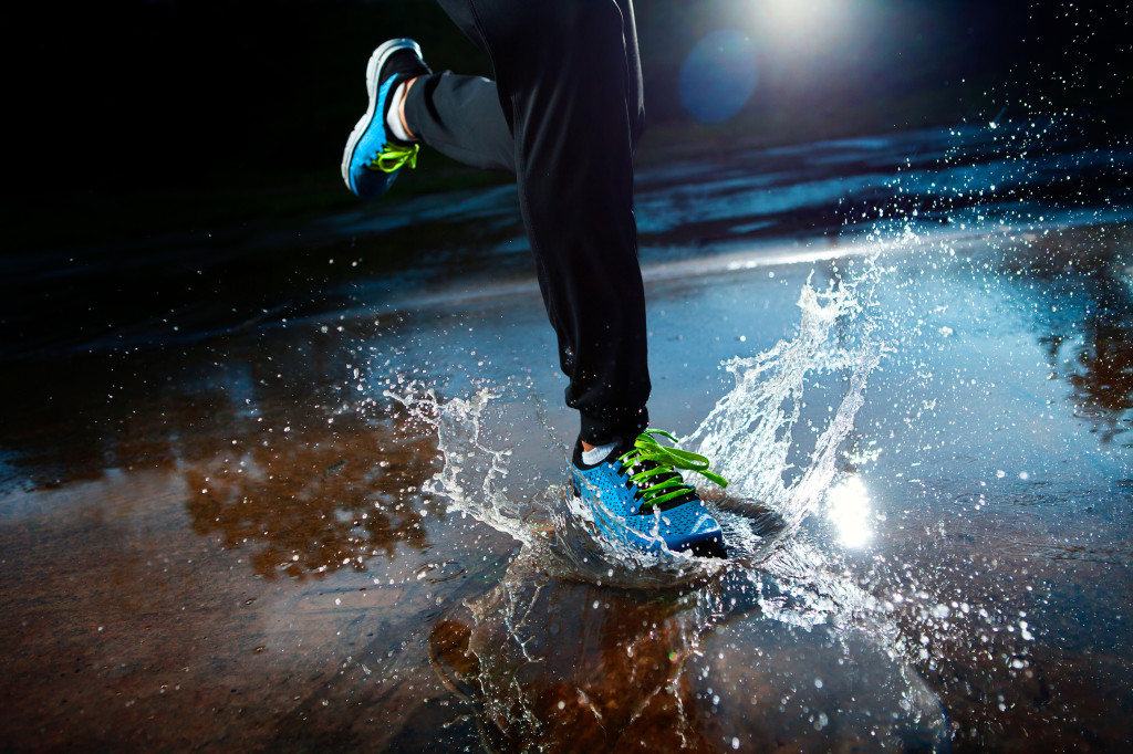 bigstock-Single-Runner-Running-In-Rain-53652316